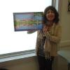 Winner of the Booker award, Jill Hargrove, with her prize, a painting by Carol Randall.