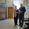 ​FNHA member Anne Trecartin with May 2016 guest speaker Mr. David Hilderbrand.