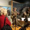 FNHA members viewing a second mannequin display depicting Canadian soldiers during World War Two.